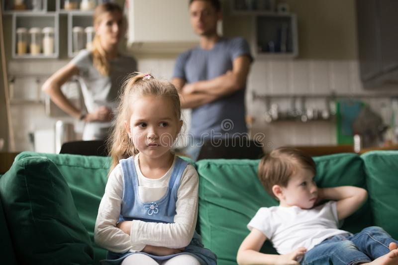 Kid girl upset, offended or bored ignoring parents and brother royalty free stock photos