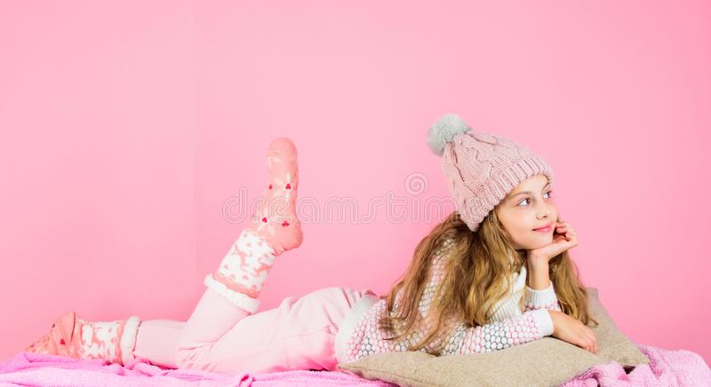 Kid girl wear cute knitted fashionable hat and scarf accessory. Winter fashion accessory. Winter accessory concept. Girl. Long hair dreamy mood pink background stock photos