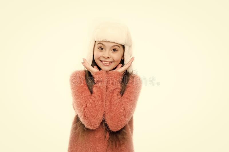 Kid girl wear hat with ear flaps white background. Soft furry accessory. Tips for caring for fur garments. Child long. Hair soft hat enjoy softness. Winter stock image