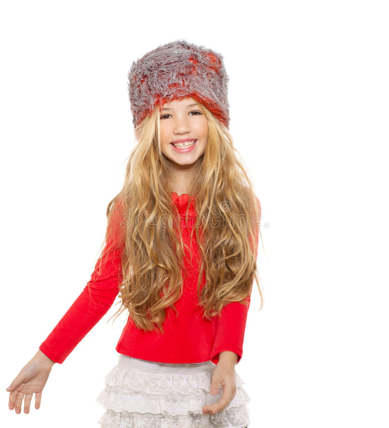 Kid girl winter dancing with red shirt and fur hat. On white background royalty free stock photography