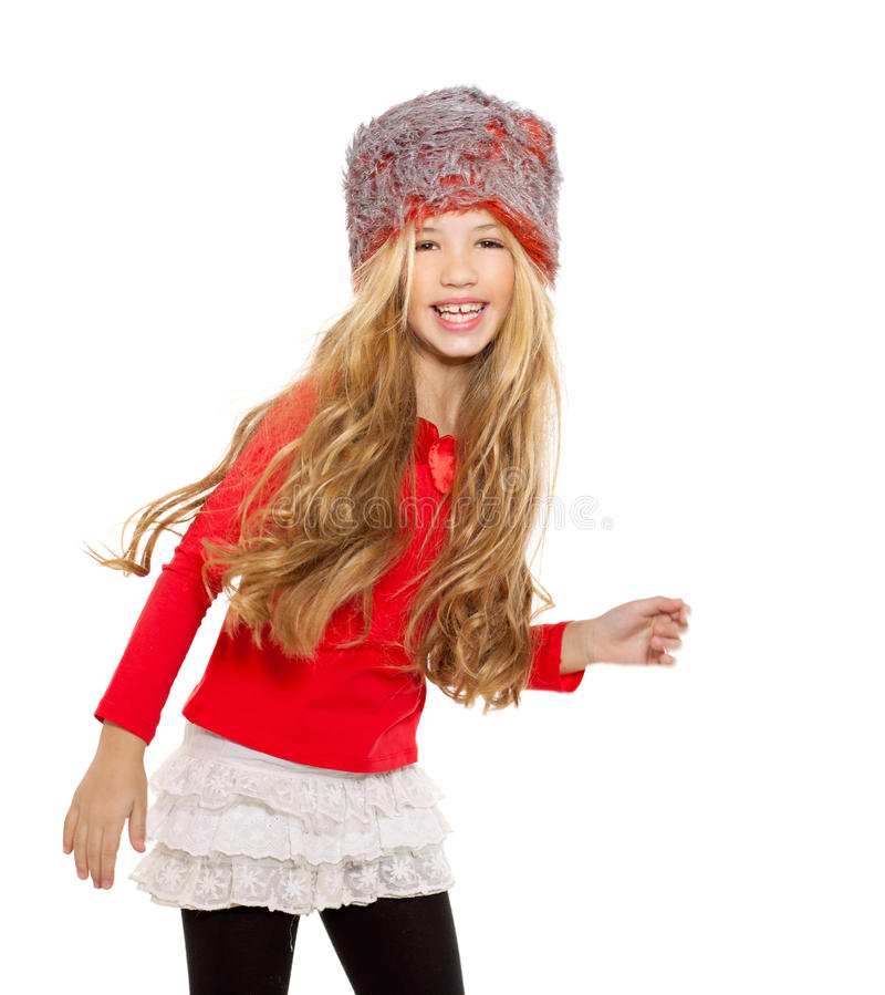 Kid girl winter dancing with red shirt and fur hat