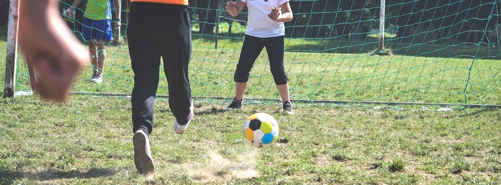 Two girls play football penalty. Two kid girls play football royalty free stock photo