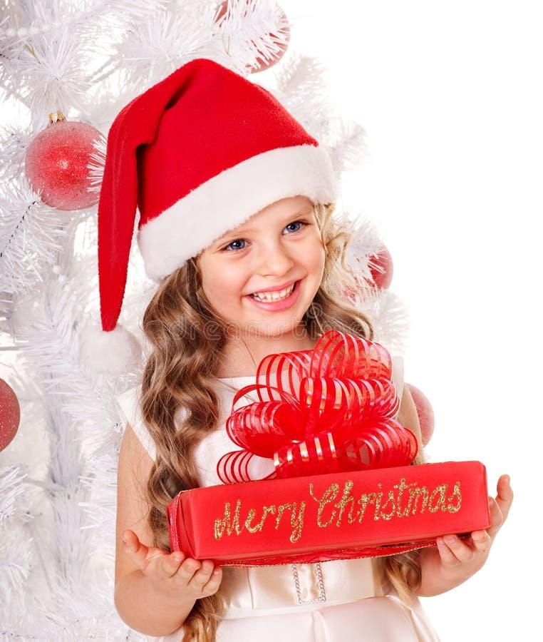 Kid giving Christmas gift box. royalty free stock photo