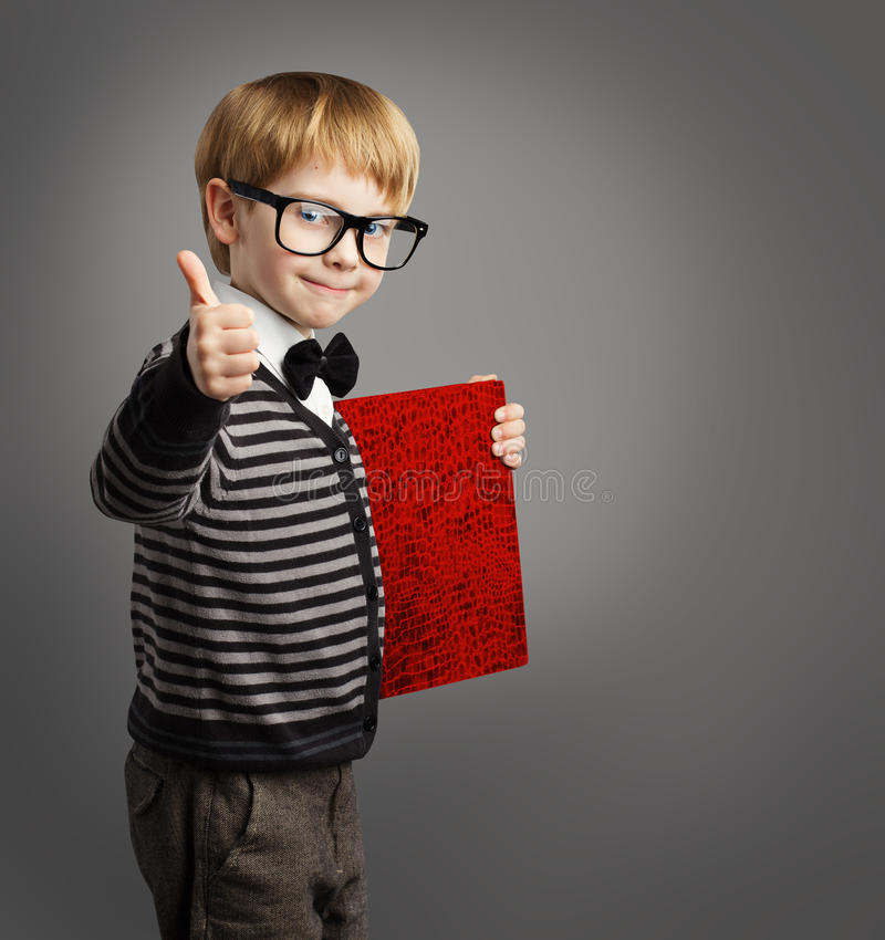 Kid in Glasses, Child Advertiser, Certificate Book, School Boy. Kid in Glasses, Child Advertiser with Certificate Book, School Boy Showing Thumb Up royalty free stock photos