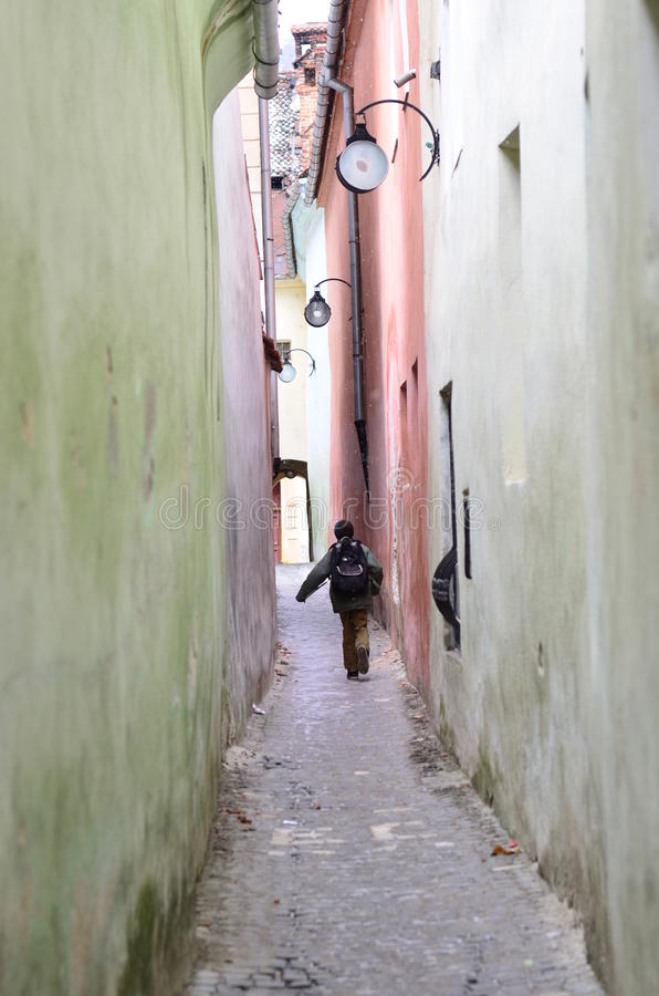 Download Kid Going To School / The Rope Street From Brasov Stock Photo - Image of human, city: 18727666
