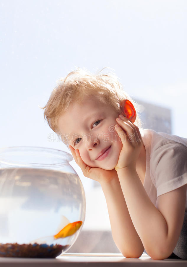 Kid and goldfish royalty free stock images