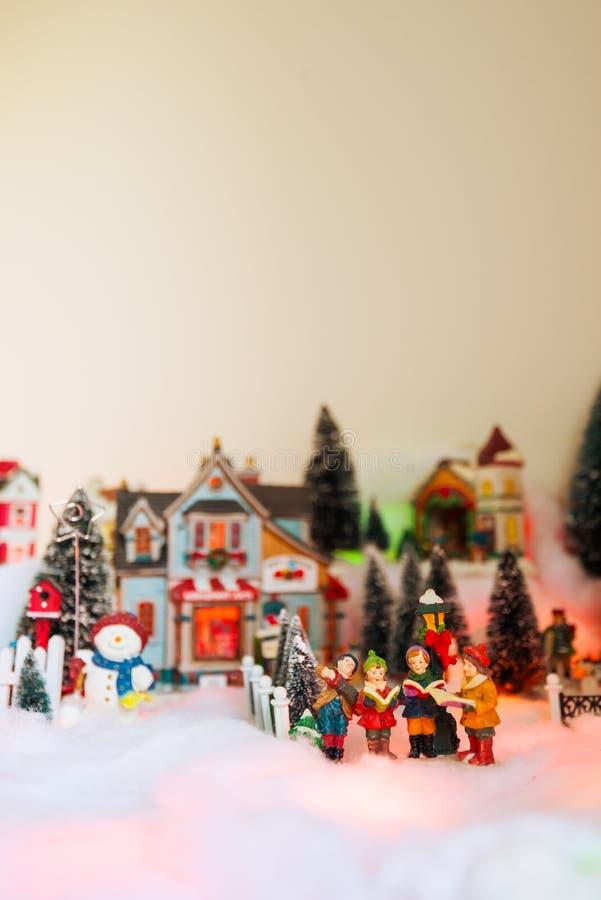 Season greeting with Christmas miniature scenery stock photography