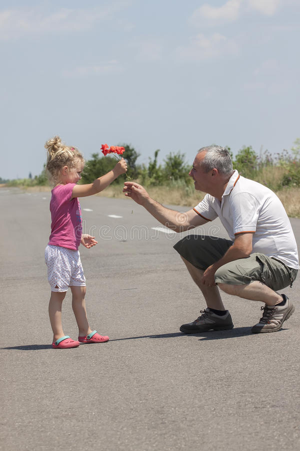 Kid and grandfather on the road stock photography