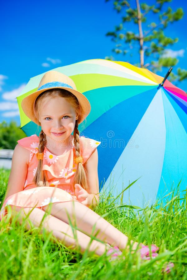 Kid on green lawn stock photography