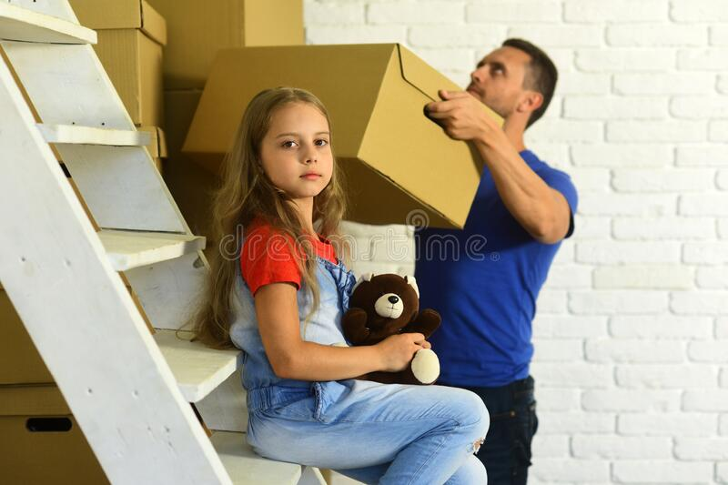 Kid and guy move in or move out. New home royalty free stock photo
