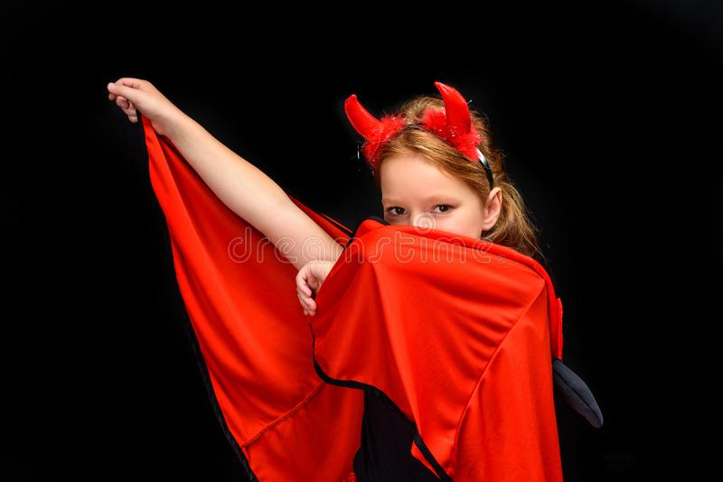 Kid in halloween costume of devil stock image