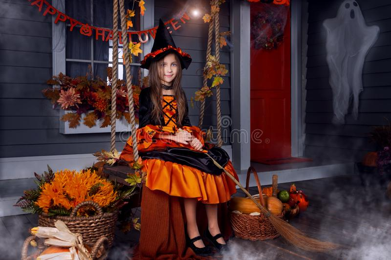 Kid in halloween witch costume ready for halloween royalty free stock photography