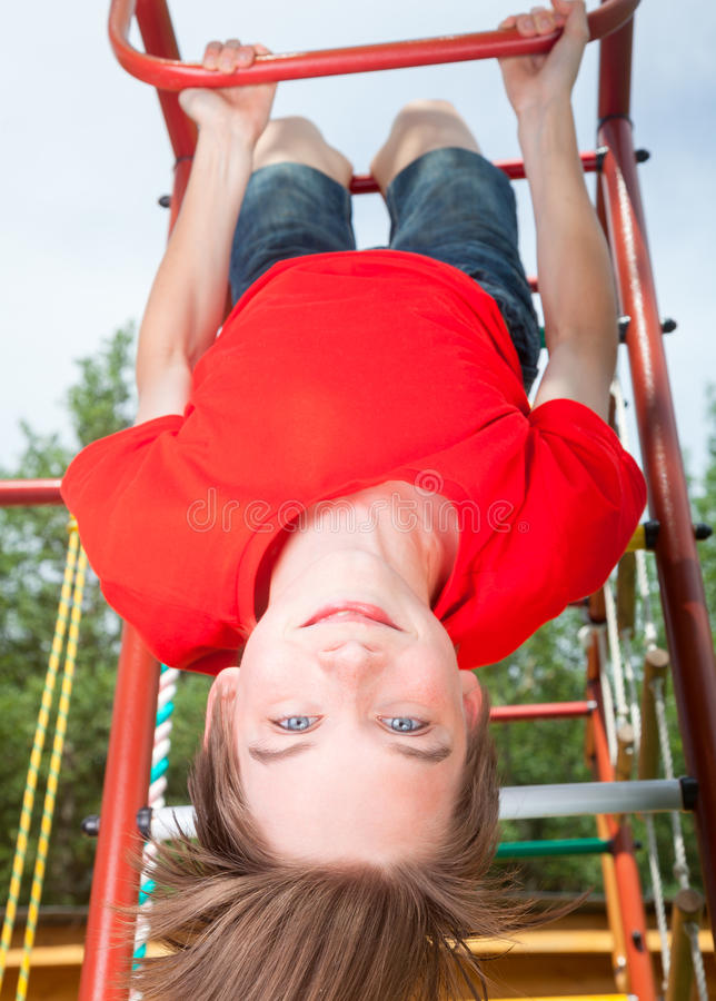 Free Kid Hanging From A Jungle Gym Royalty Free Stock Photos - 73765528