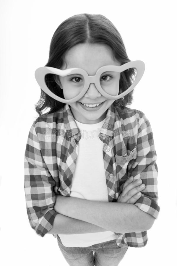 Kid happy lovely feels sympathy. Child charming smile fall in love. Girl heart shaped eyeglasses celebrates valentines. Day. Girl cute smiling face heart royalty free stock photos