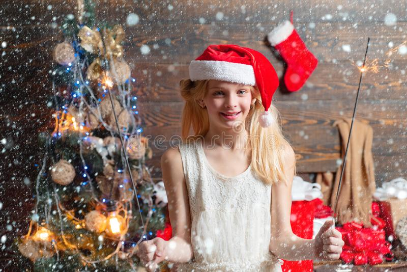 Kid having fun near Christmas tree indoors. Children gift. Christmas card. Portrait of happy Little girl looking at royalty free stock photos