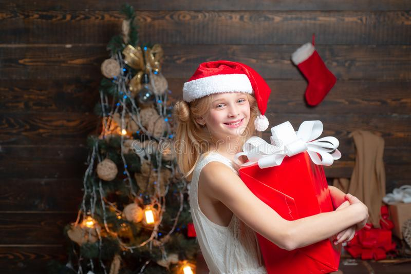 Kid having fun near Christmas tree indoors. Merry Christmas and Happy New year. Christmas children. Cute little girl royalty free stock photography