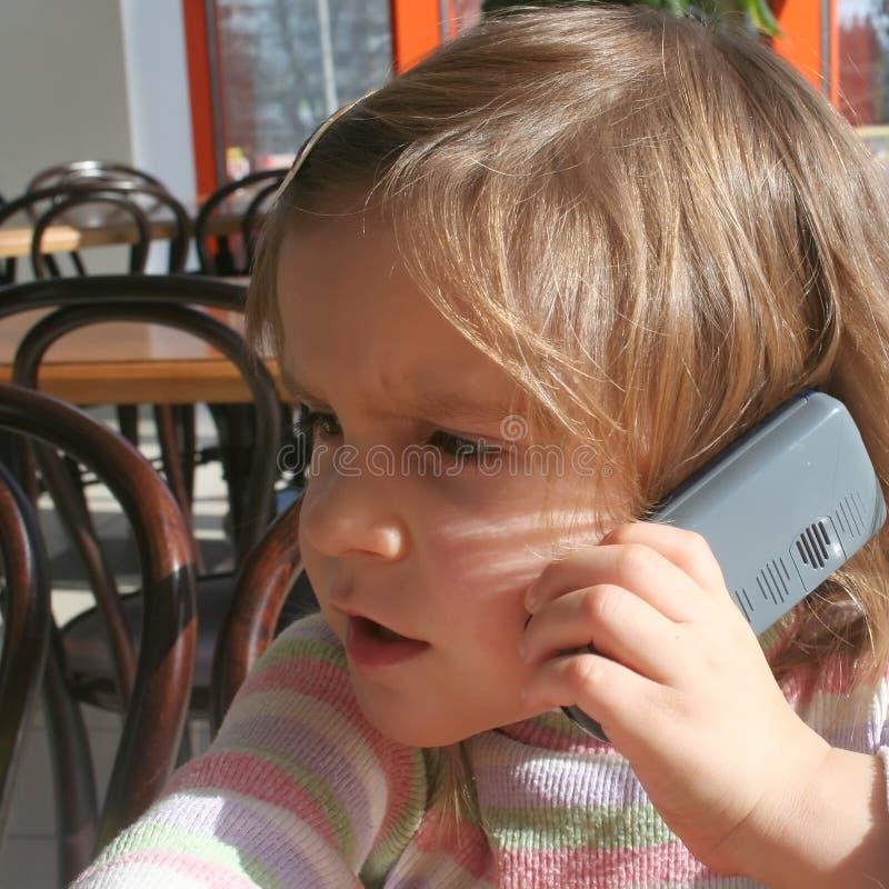 Kid having a telephone call stock photography