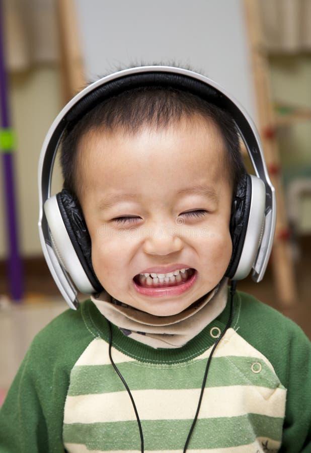 Kid with headphone. Kid enjoy music with headphone stock photo