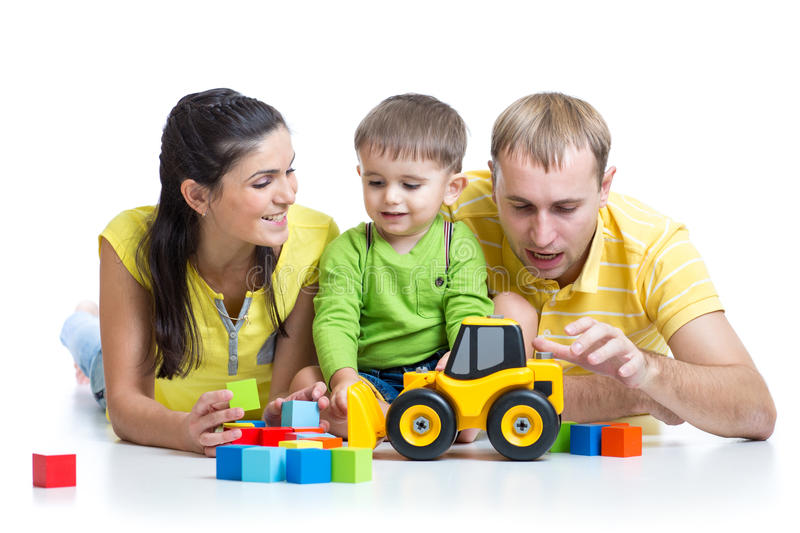 Toys For Parents : Kid with his parents play building blocks toys stock image