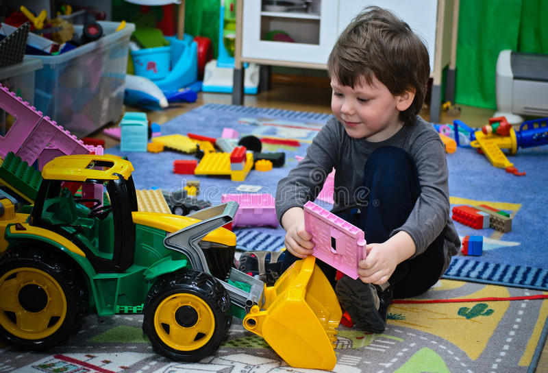 The kid and his toy tractor royalty free stock images