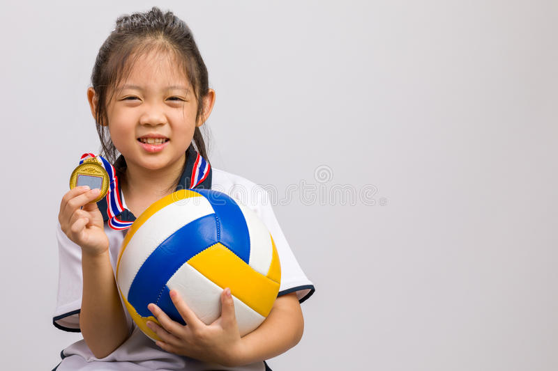 Kid Holding Ball and Gold Medal, Isolated on White royalty free stock photos