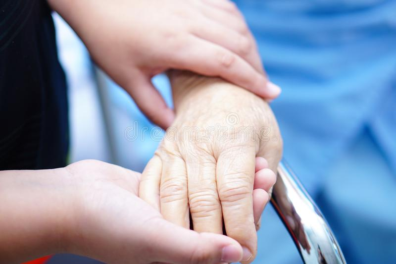 Kid holding hand Asian senior or elderly old lady patient with love, care, encourage and empathy. Kid holding hands Asian senior or elderly old lady woman royalty free stock photo