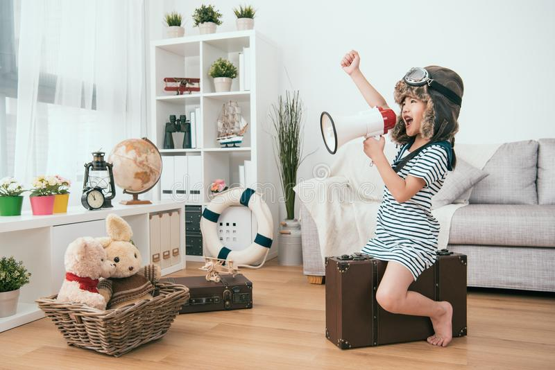Kid holding a megaphone and raising a hand. She`s ready for the next round royalty free stock photos