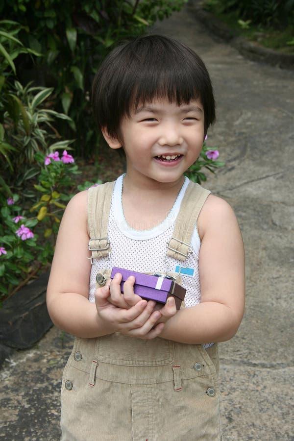 Kid holding present royalty free stock photo