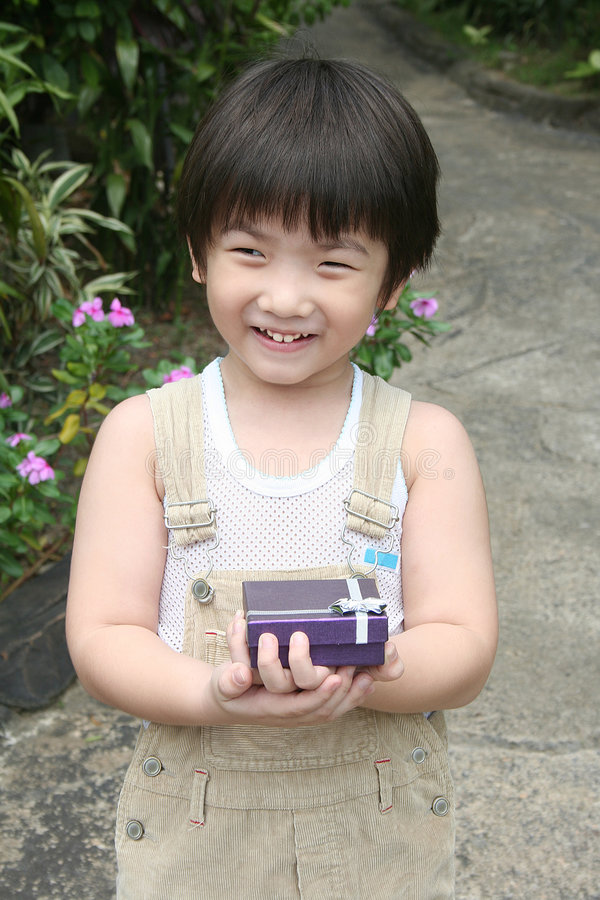 Kid holding present royalty free stock image