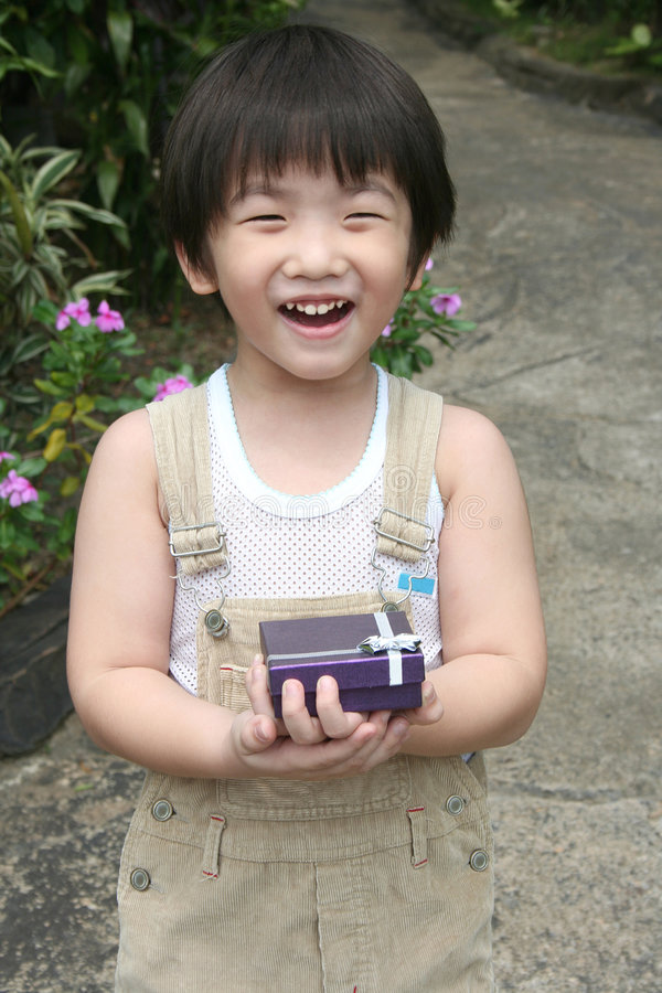 Kid holding present royalty free stock photography