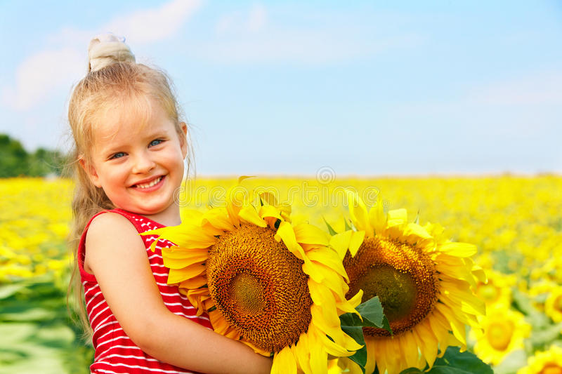 Kid Holding Sunflower Outdoor. Royalty Free Stock Image