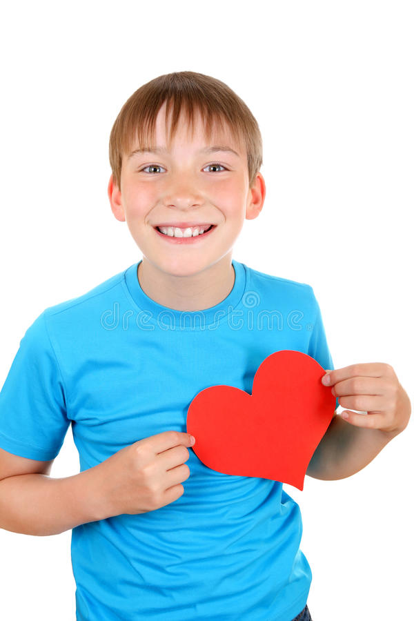 Kid holds Red Heart Shape. Cheerful Kid with Red Heart Shape Isolated on the White Background royalty free stock photography