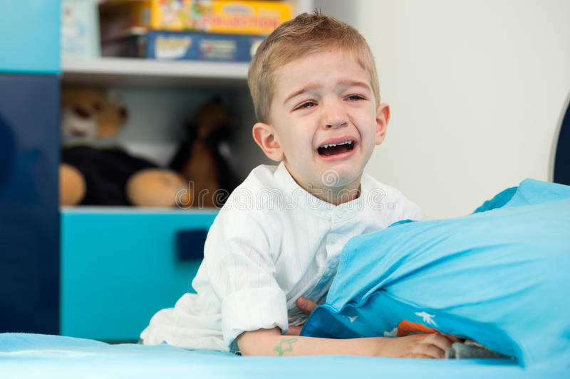 Kid at home crying royalty free stock photography