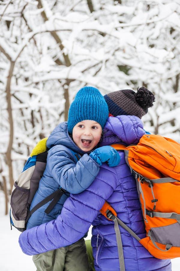 The kid hugs Mom. royalty free stock photo