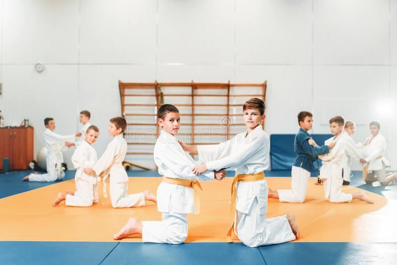 Kid judo, children on fight training, martial art. Self-defense. Little boys in uniform in sport hall, young fighters royalty free stock photos