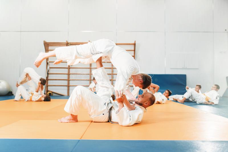 Kid judo, young fighters on training royalty free stock photography