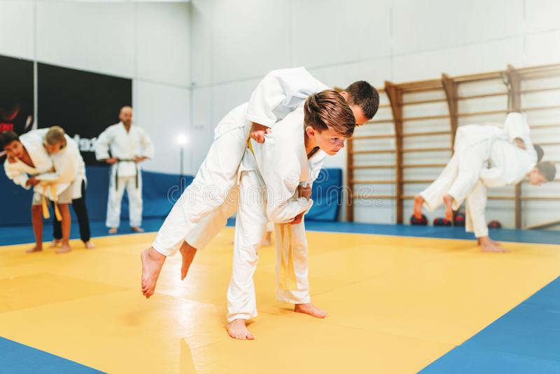 Kid judo, young fighters on training, self-defense royalty free stock photos