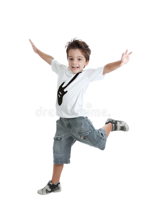 Kid jumping with a tshirt with a guitar painted. A kid jumping in the air, with a nice tshirt with a guitar painted on it. Isolated on white stock image