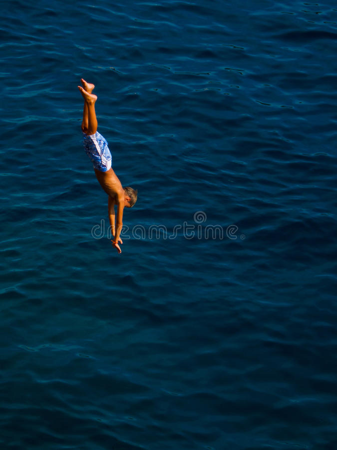 Kid jumping in the water royalty free stock photos
