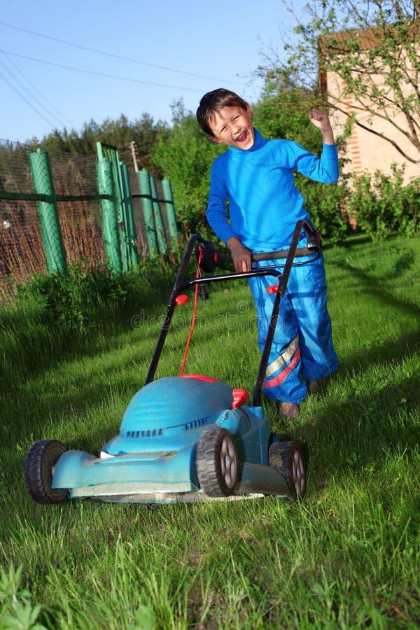 Kid lawn mower royalty free stock photo