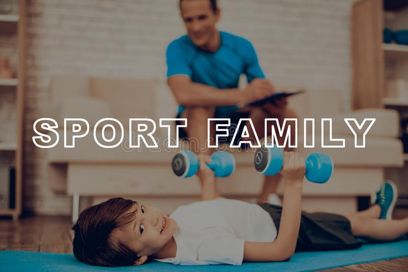 Kid Is Laying On Gym Carpet. Dumpbells Exercises. Active Holiday. Sports Clothes. Getting Better. Working Out At Home. Training Day. Repeating Practice. Body royalty free stock photography