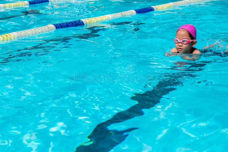 Kid learn how to swim in swimming class. Competition, swimming pool royalty free stock photography