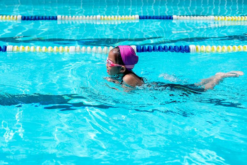 Kid learn how to swim in swimming class. Competition, swimming pool royalty free stock image