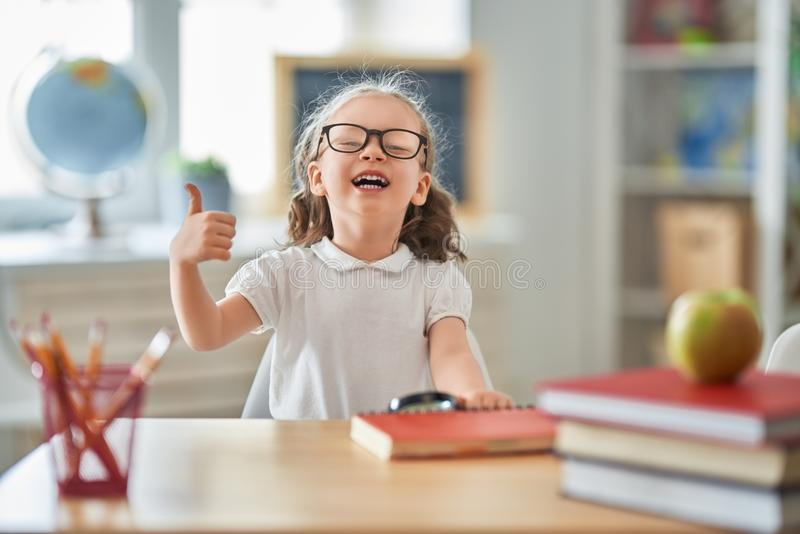 Kid is learning in class stock photography