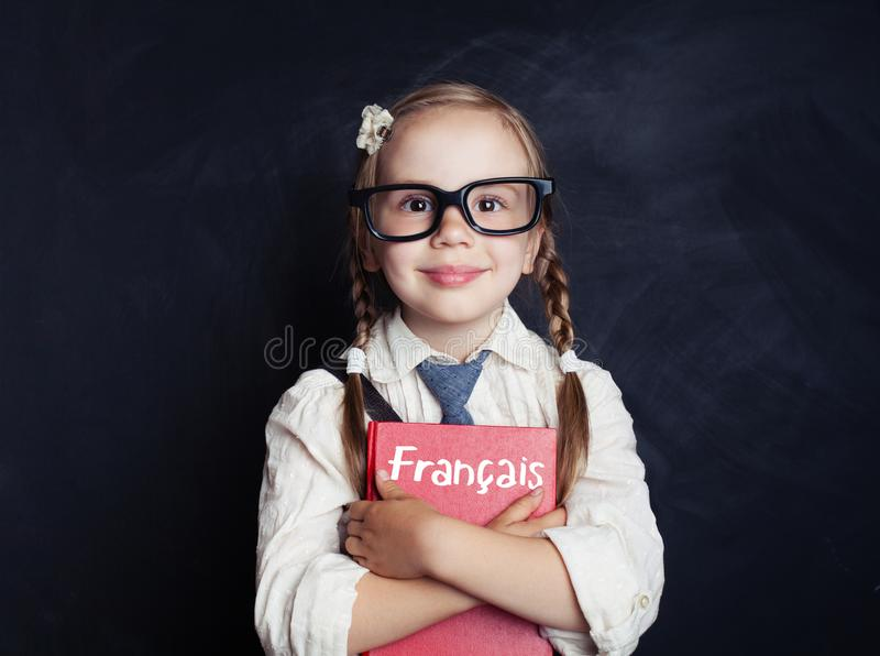 Kid learning french in language school. Happy little girl royalty free stock photos