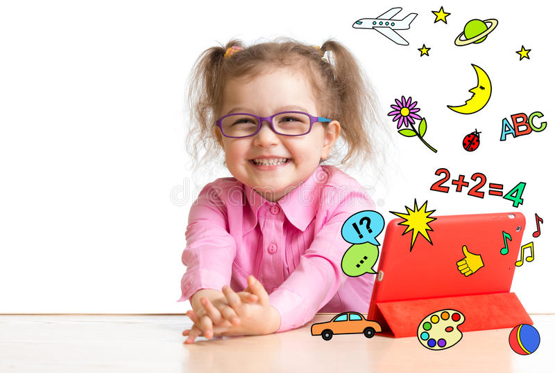 Kid learning or playing with tablet computer. Isolated stock photo