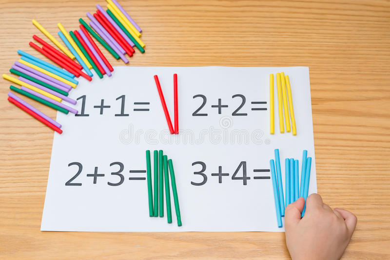 Kid learning simple addition royalty free stock images
