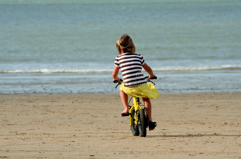 Kid learning to ride stock photography