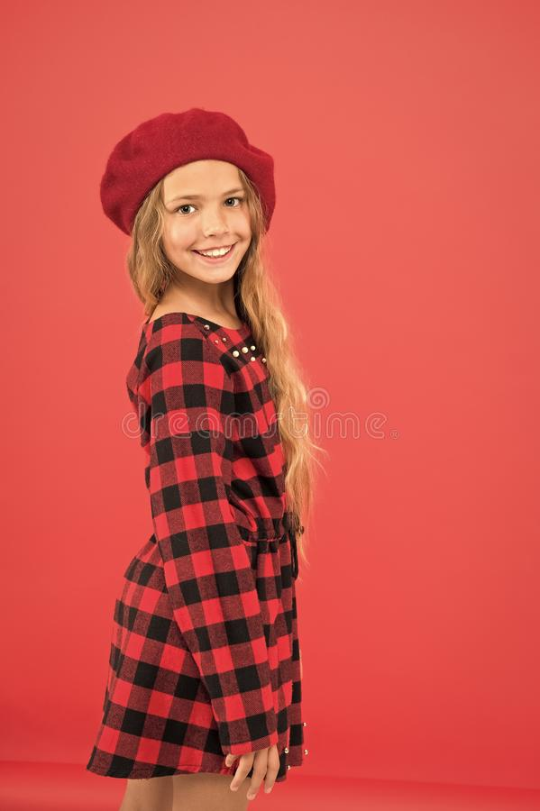 Kid little cute girl with long hair posing in hat red background. How to wear french beret. Beret style inspiration. How royalty free stock image