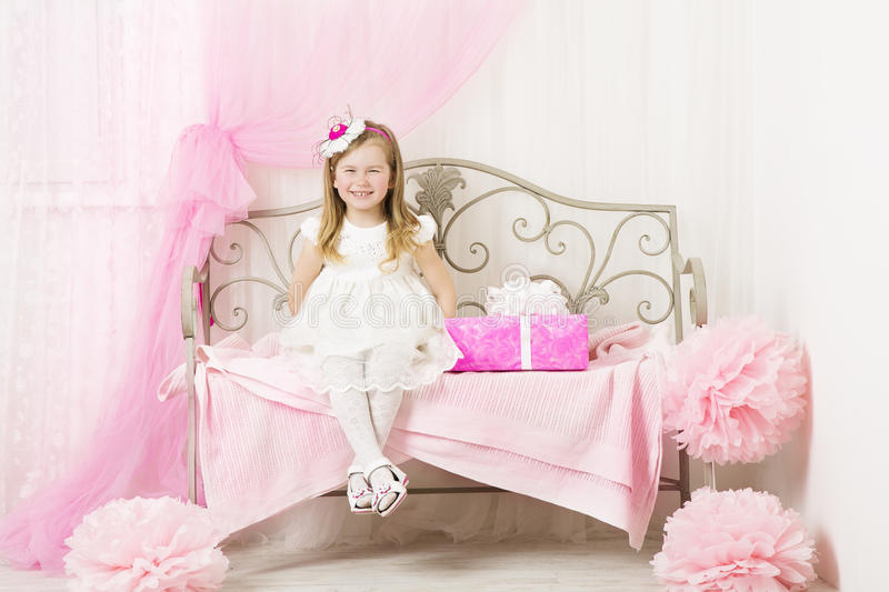Kid Little Girl Portrait Child, Pink Present Gift Box. Kid Little Girl Portrait, Smiling Child four years with Pink Present Gift Box in Decorated Children room stock images
